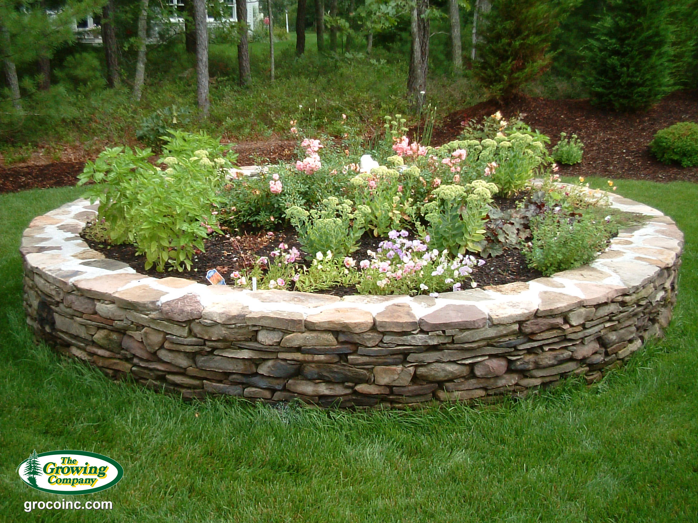 Outdoor flower pot planter installation for cotuit for Flower bed wall designs