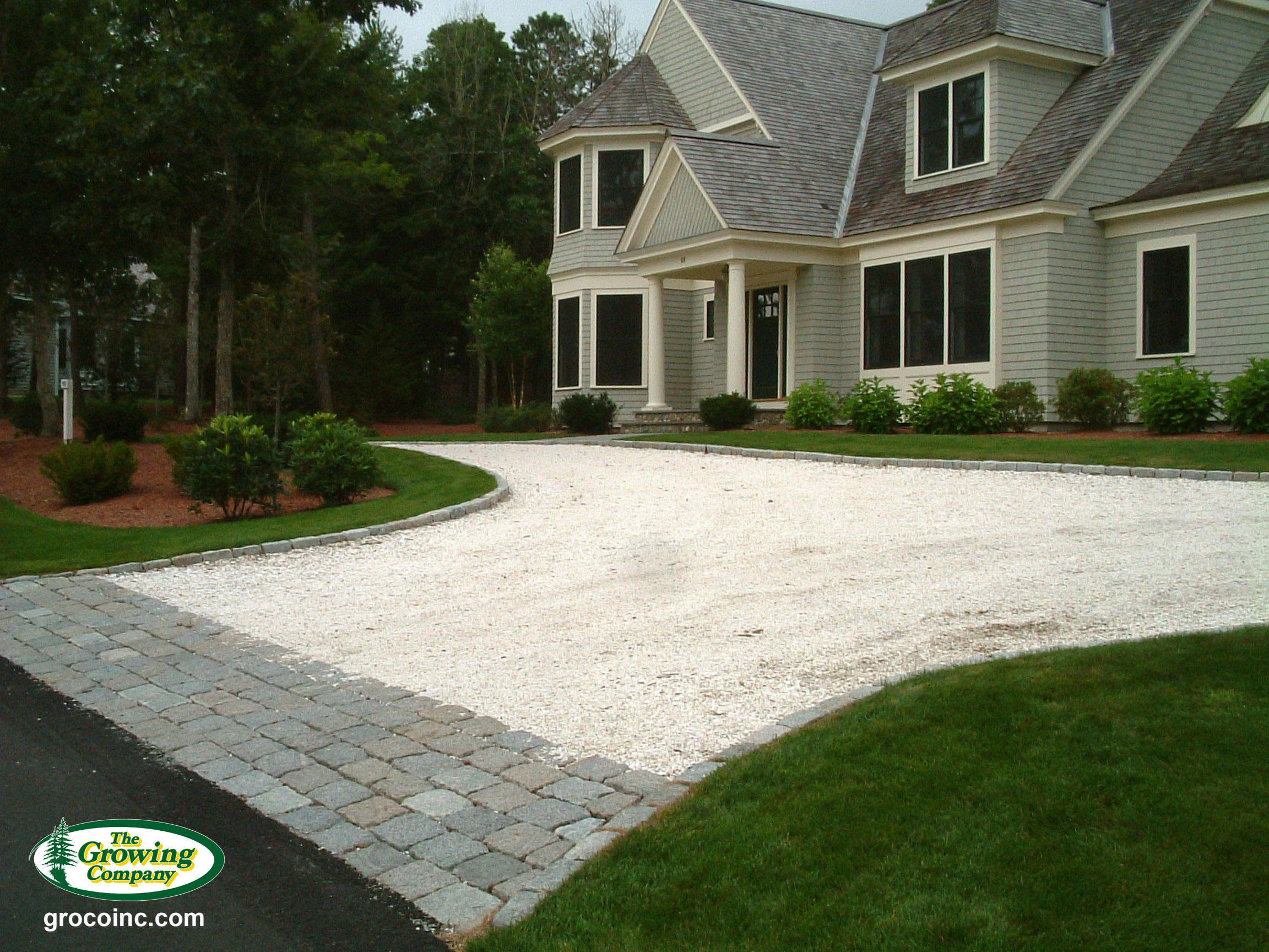 Cobblestone driveway aprons edging for cotuit for Landscaping rocks new orleans